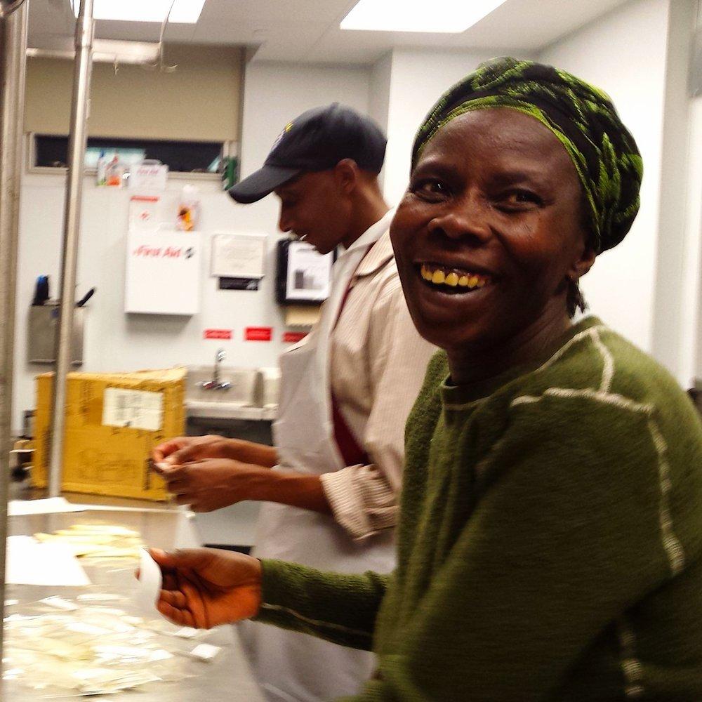 Faranswazi smiles while labeling with Nzitonda and Murekatete.jpg