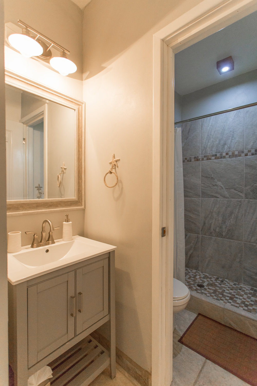 Our serene bathroom area has a separate room with shower and toilet....
