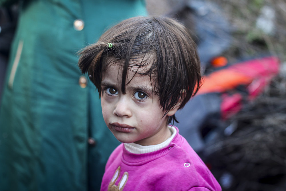 A young Syrian refugee just moments after her arrival to the shores of Lesvos. October 2015.