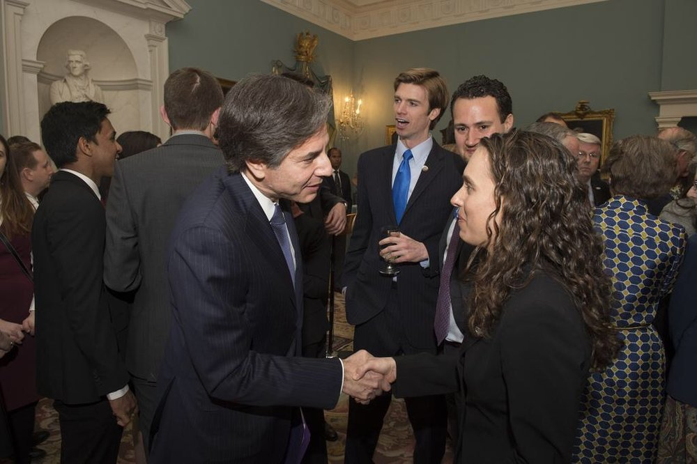 Greeting Deputy Secretary of State Antony Blinken at a March 2015 reception at the State Department
