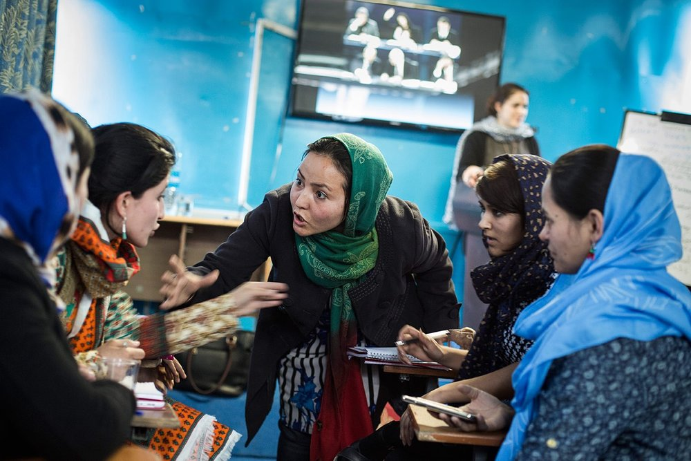 Afghan women receiving journalism training at  Sahar Speaks