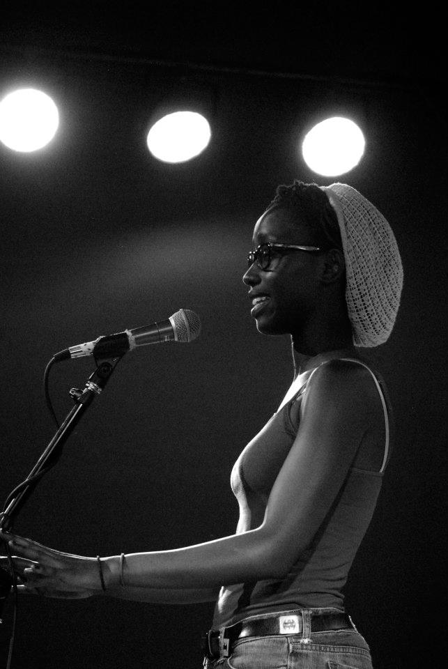 Mic Check Poetry offers a free, open space to voice opinions and perform original work. Here: a member performing her original poetry on stage. Common themes center around racial and gender equality, love and life