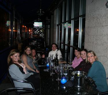 Ladies enjoying happy hour at State & Allen Kitchen + Bar