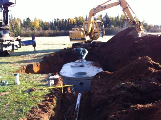 The new septic tank goes in before the ground freezes
