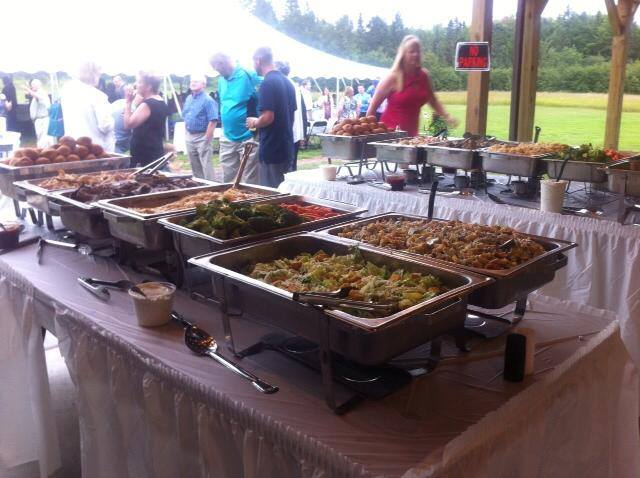 Caterers set up a buffet