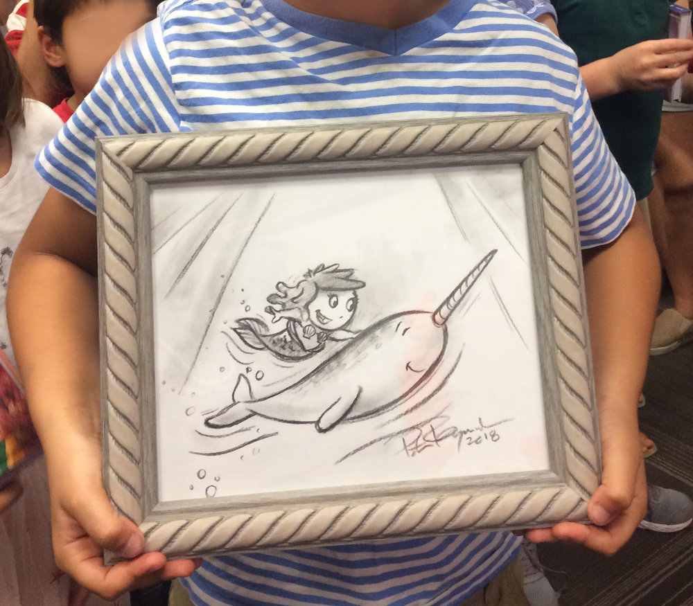 Original charcoal drawing of Cora and a narwhal.