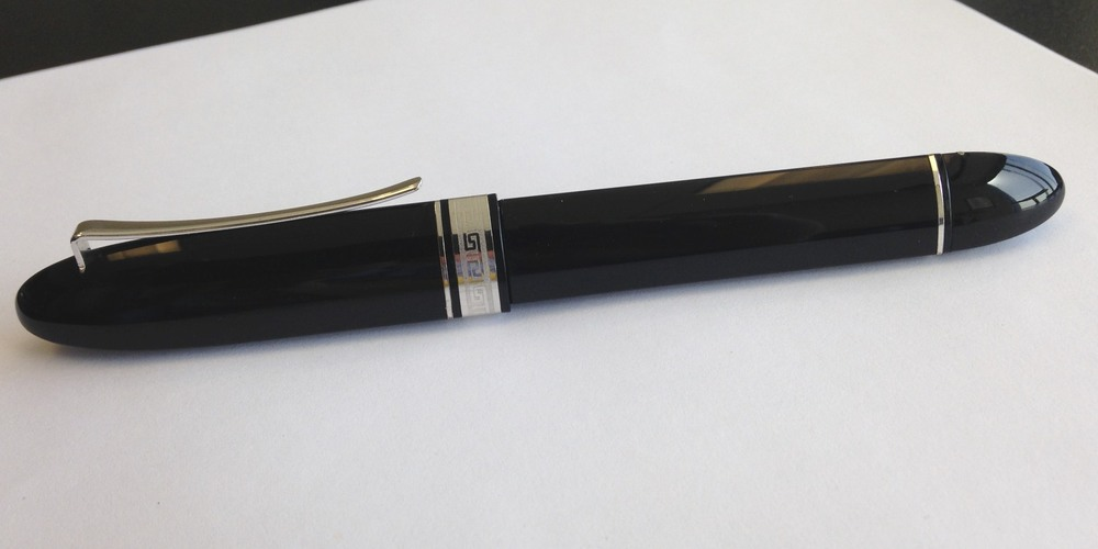"I love the lines on this pen.  It's triangular in shape, so it won't roll off the desk.  I'm also a huge fan of the Omas ""greek key"" trim."