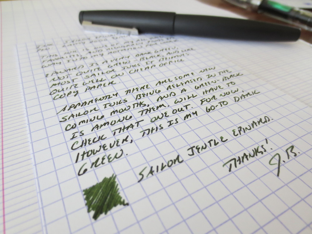 "For the non-Francophones, ""Epinard"" is the French word for spinach.  It's a fair descriptor.  Although there's a good bit of black in the green, you're still writing with green ink.  This ink is loaded into my Lamy 2000 with an EF Nib.  A very professional ink in a professional pen."