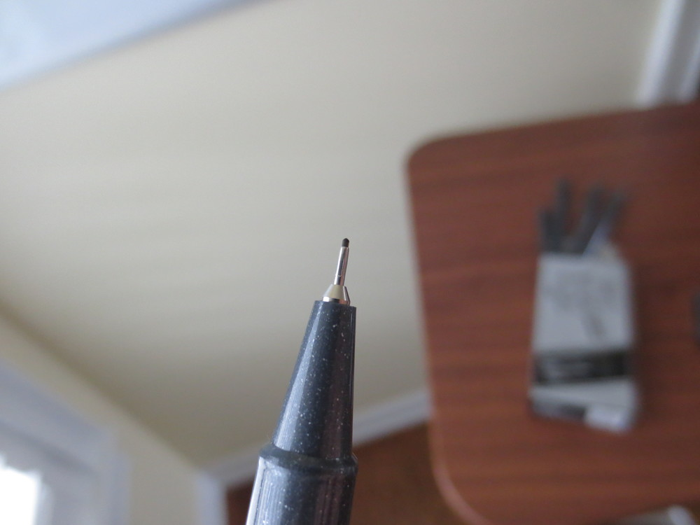 This is the tip after two-weeks of heavy use.  Minimal, if any, breakdown, and the pen is still going strong.  I suspect that if I had used fineliners prior to using fountain pens, tip durability might be an issue, but for fountain pen users who are accustomed to writing with less pressure, durability is less of a concern.