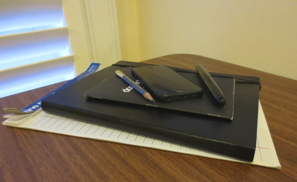 My current notebook carry:  Iphone 5, Doane Paper large Utility Journal; Twsbi softcover notebook (lined), and Doane Paper pad.