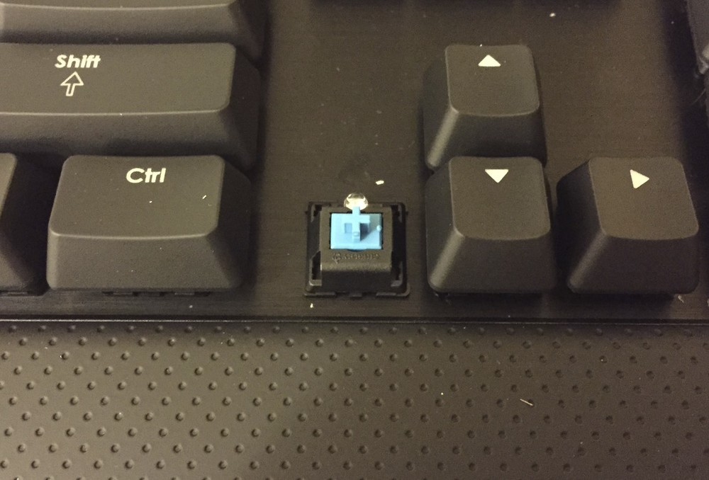 My Cherry MX Blue mechanical keyboard with switch exposed.  The keyboard with the Blues otherwise looks identical to the keyboard with the Reds.