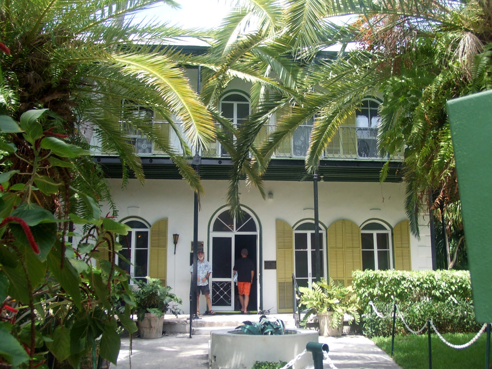 Ernest Hemingway Home and Museum, Key West, Florida.   Gorgeous Photo courtesy of Grammaticus Bramlington , licensed via  Creative Commons .