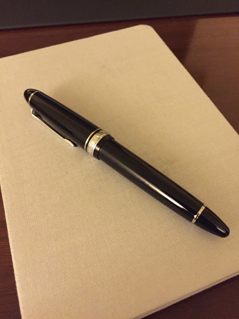 My Sailor 1911 Large with a Nagahara-tuned music nib, atop my Baron Fig Confidant.