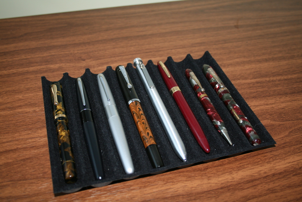 From Left:  Vintage Conklin Endura in Bronze & Black Marble, standard size.  Restored with new sac, good condition, spots of brassing on the clip ($215); Pilot Metropolitan in Black (Medium) ($8); Pilot Metropolitan in Silver (Fine) ($8); Noodler's Konrad in Methuselah's Pinecone Ebonite (Flex Nib) ($20); Karas Customs G2 Bolt ($35); Sheaffer Snorkel (14K Medium Admiral (non tubular) nib, restored) ($55); Vintage Viceroy Pen/Pencil Set (Fine Gold Plated Nib, Restored) ($10).
