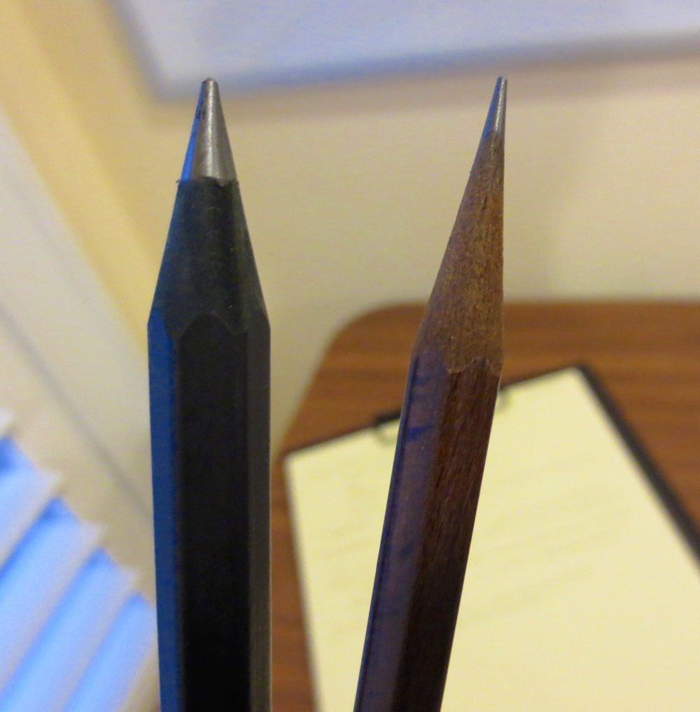 The point on a Swiss Wood Pencil lasts forever.  You can also see the size difference between the Swiss Wood (on the right), and the Black Wood (on the left).  For it's size and hardness, the Black Wood doesn't do a bad job with point retention, either.