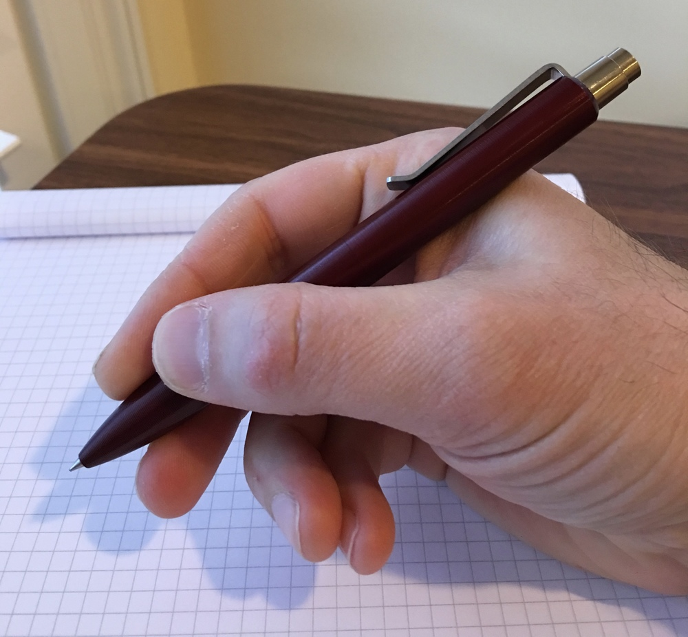 Tactile Turn Mover machined pen in hand