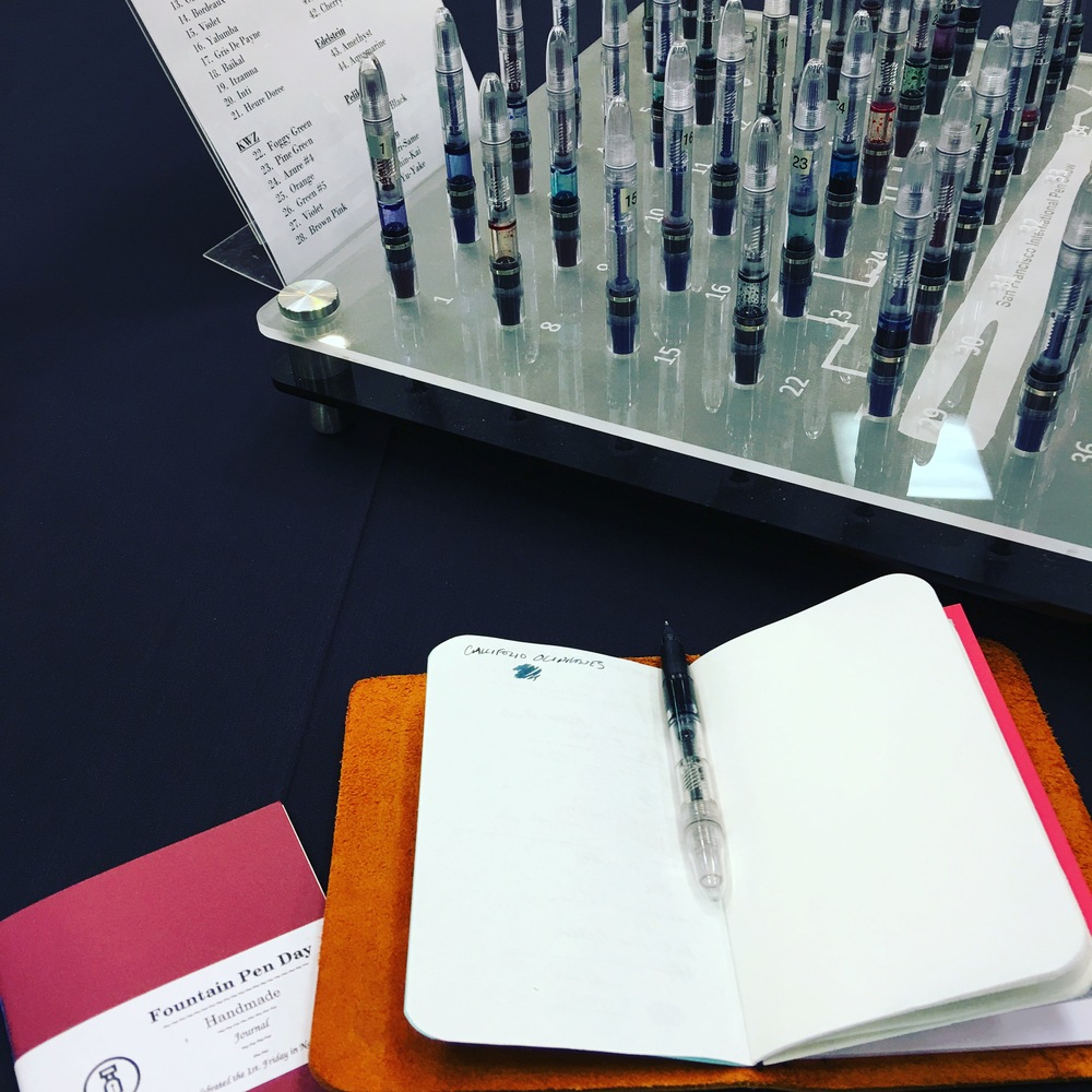 Playing at the Atlanta Pen Show Ink Testing Station, in my Fountain Pen Day notebook.  How cool is this thing?  Much better than the open bottles and dip pens at D.C.  I was very pleased to discover KWZ Ink.