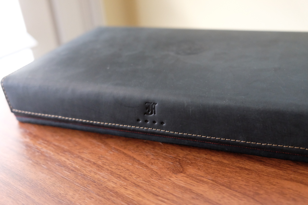 "I love the matte look of the ""boot black"" leather.  It's embossed with the Franklin-Christoph logo on two places:  the top of the lid and the foldover hinge."