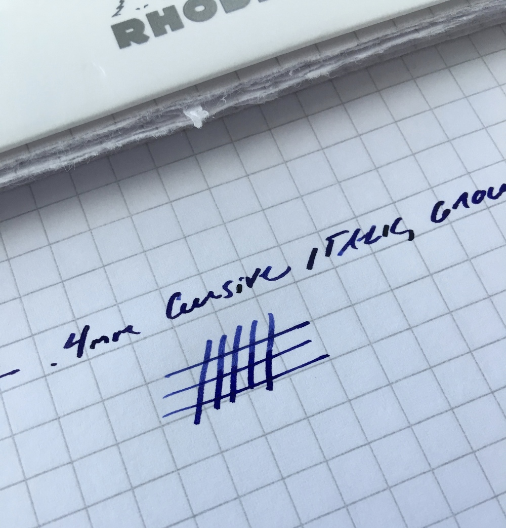 This .4mm cursive italic (formerly a medium nib) writes perfectly for me.  Ink is Aurora blue.