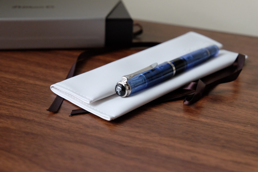 "The Pelikan M205 on its white faux-leather envelope-style packaging.  (A ""penvelope?"")"