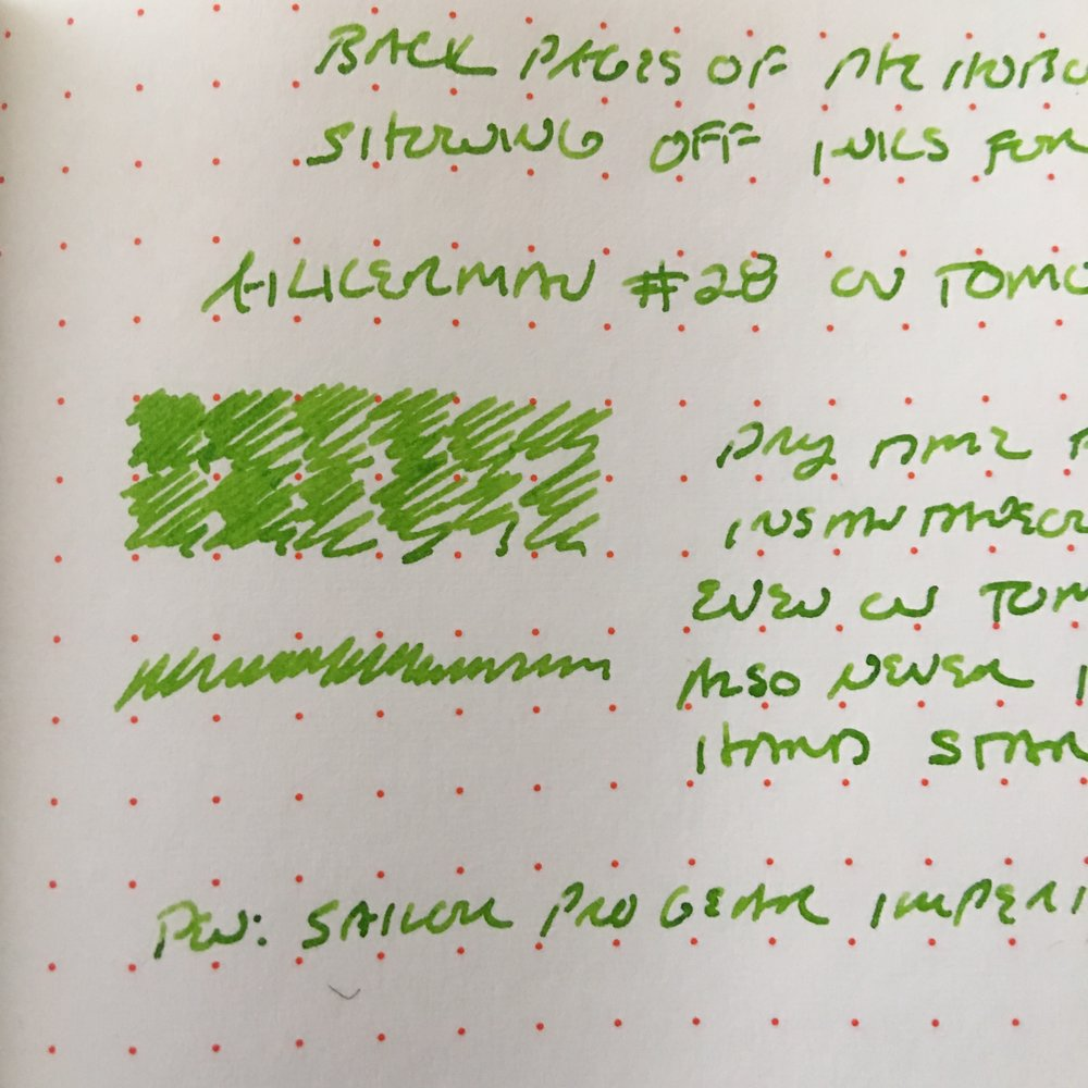 Akkerman 28 is an extremely bright ink, but it's not pale at all. It will stand out on most papers. You can see here that it stands up to the bright red dots of the  Hobonichi Techo  paper. (This writing sample is from the blank sheets at the back of the journal.)
