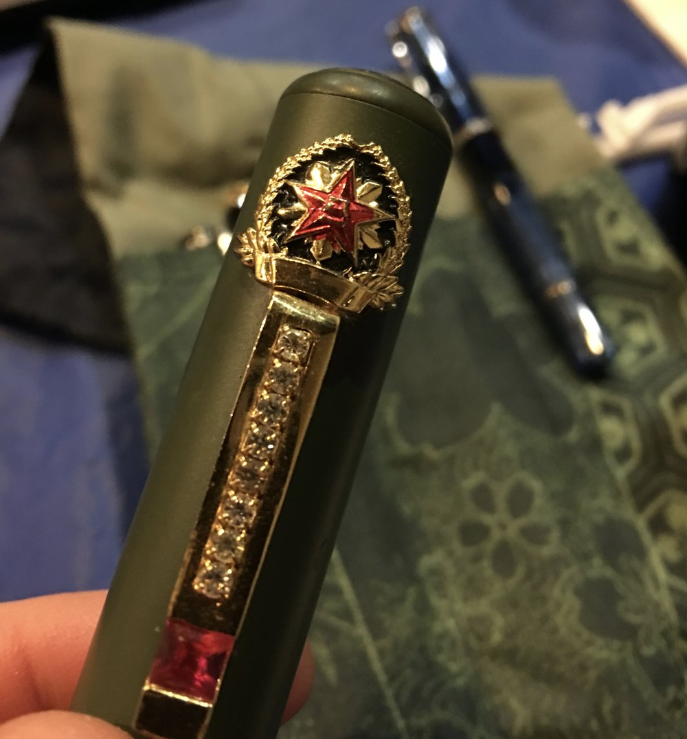 Chinese Army Pen Star on the Cap
