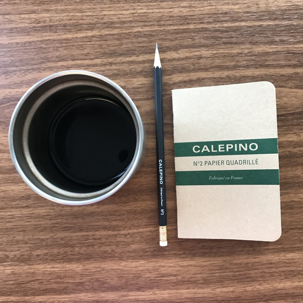 my morning companions calepino graph paper notebook and a calepino pencil and coffee