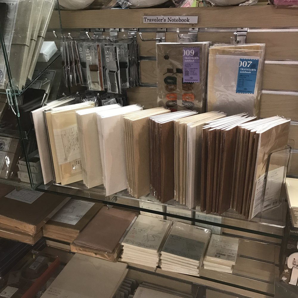 Kinokuniya Bookstore has the full array of Midori Travelers Notebooks and refills.