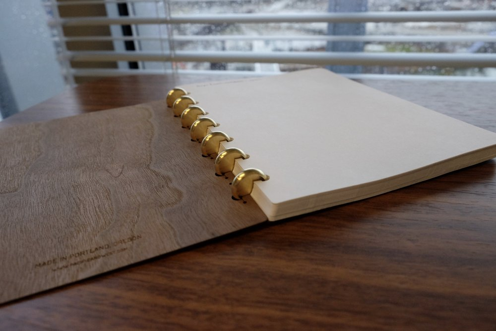 The brass discs that form the spine of the Pacific & West notebooks are absolutely gorgeous. They'll also form a nice patina over time.