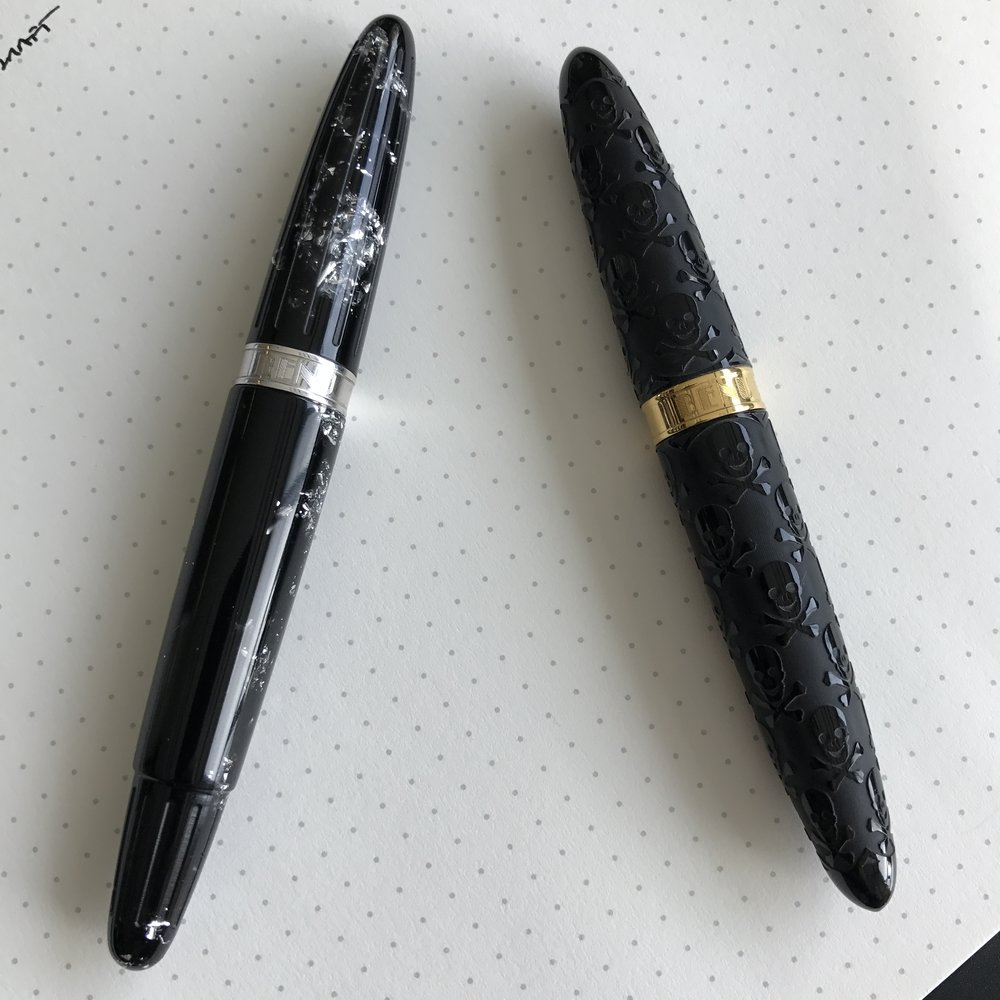 "A size comparison between the Benu ""MINIMA"" Skull Pen (right) and the ""Essence"" in Silver Galaxy (left)"