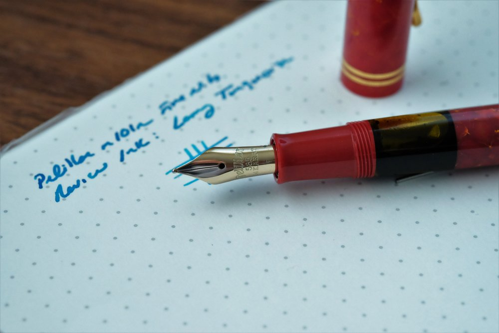 Vintage-inspired engraving on the Pelikan M101N Bright Red