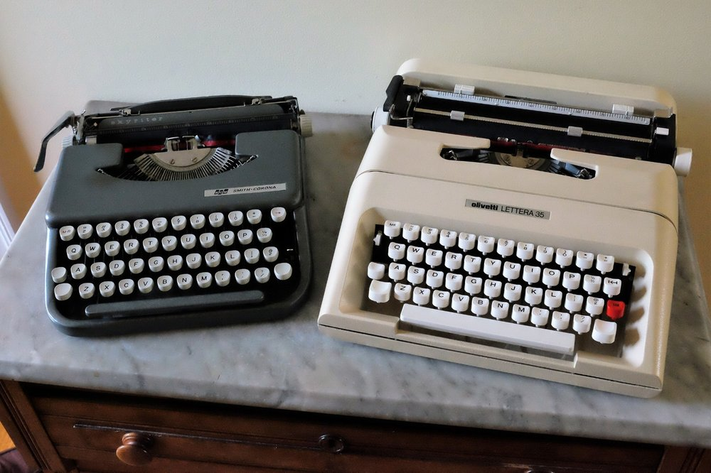 On the left, a Smith-Corona Skyriter Portable (circa 1960s), and on the Right, an Olivetti Lettera 35 (circa mid-1970s). More information at the bottom of this post!