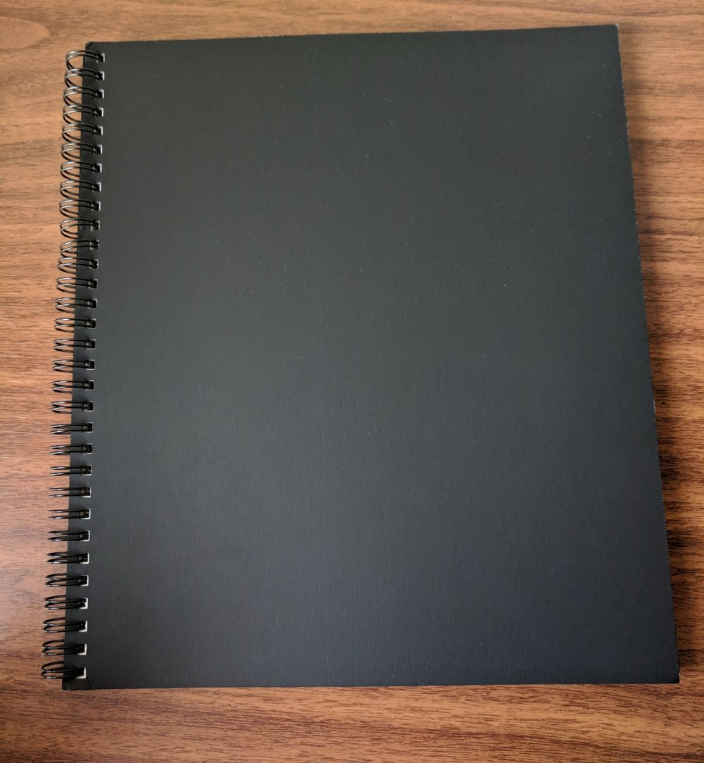 The Action Method Notebook is a great basic, black spiral-bound book that will seamlessly blend in around the office.