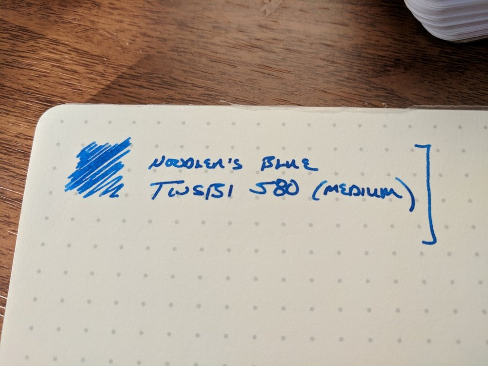 While Noodler's Blue isn't what I would call a heavy shader, you will probably see a bit of shading and variations of tone and color with a wider nib.