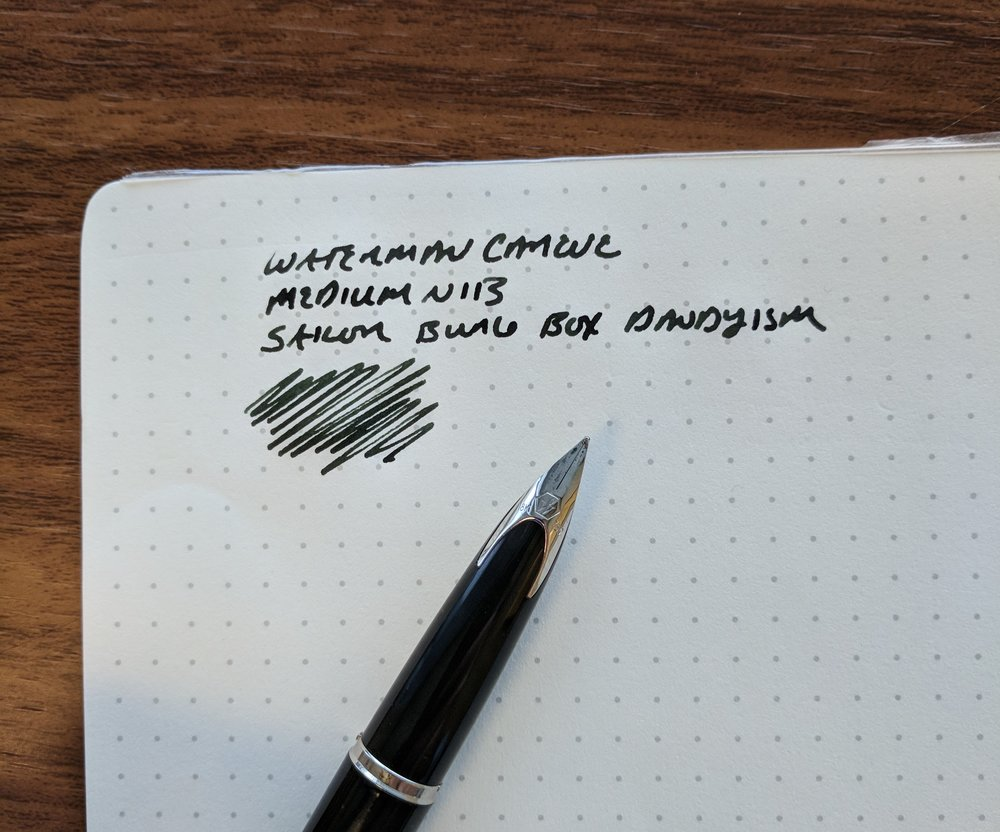"A writing sample with  Sailor Bung Box Dandyism , a very dark green-black. Don't expect any bounce or flex whatsoever out of modern Waterman nibs. They're very firm, and it would be fair to call them ""nails."""