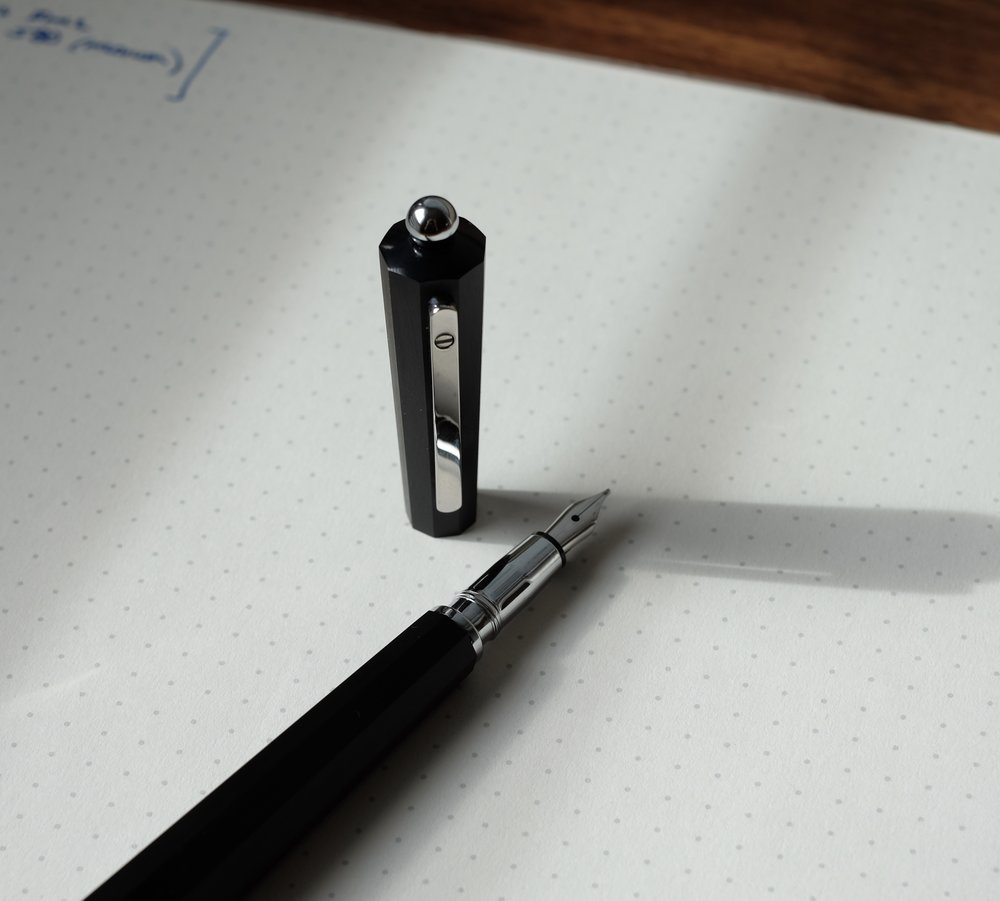 There is no scrollwork or adornment on the stainless nib, lending the pen a very clean look that doesn't distract from the faceted body and hourglass shape.