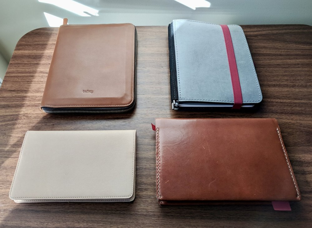 "My 2018 Notebook / ""Planner"" Loadout, Clockwise from Top Left: The Bellroy A5 Work Folio loaded with a Midori MD A5; Roterfaden Taschenbegleiter A5; Baron Fig Confidant with One Star Leather Cover; Nanami Paper Cafe Note B6 with Gfeller Leather Cover."