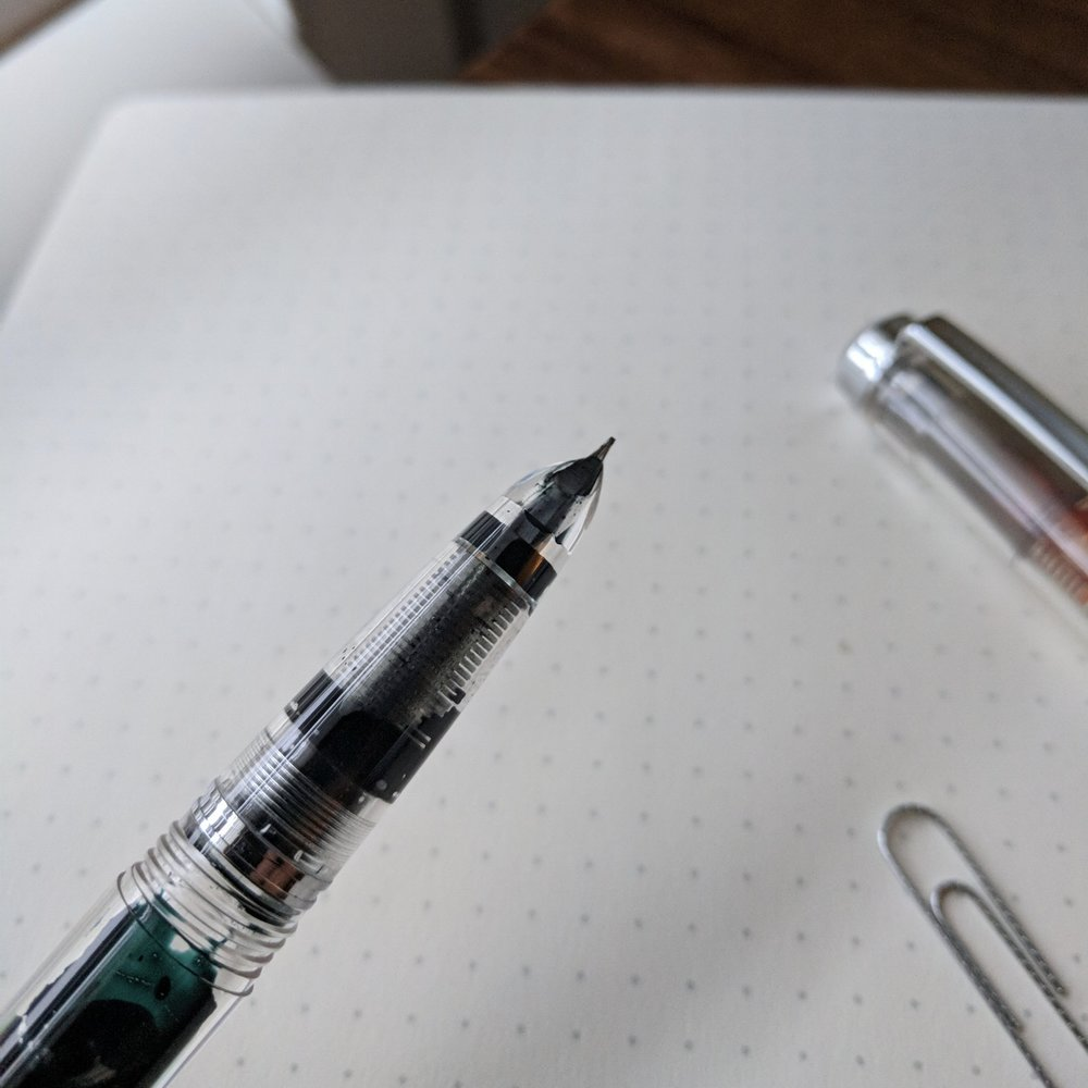 I love vintage-style hooded sections, and other than the  Aurora DuoCart  and the  Lamy 2000 , not many pen companies use them today.