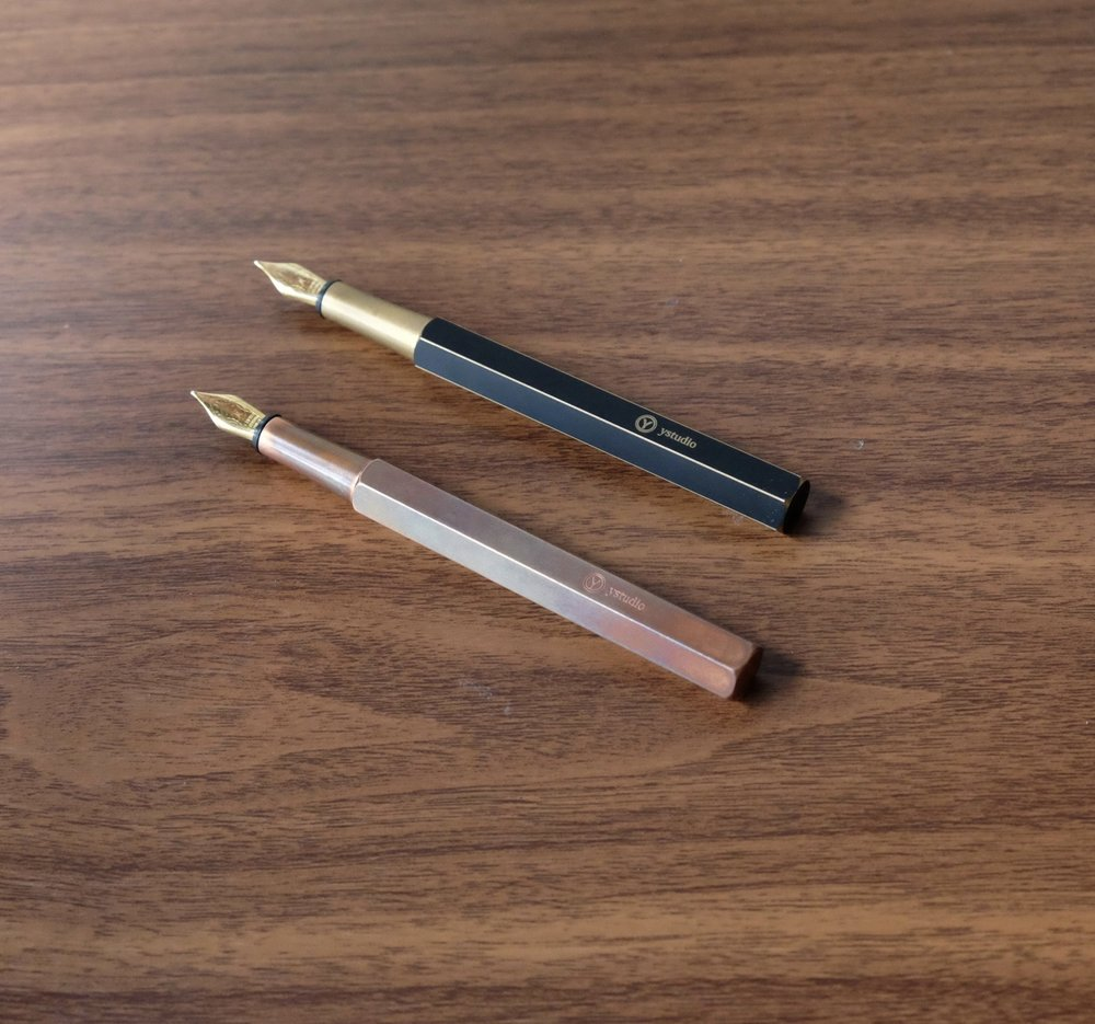 "The yStudio Portable fountain pen in ""Brassing"" finish (top) and Copper (bottom)."