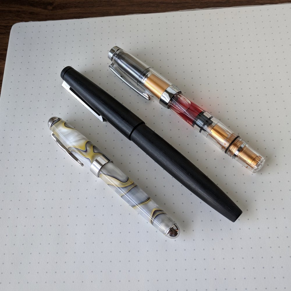 Size comparison, from left: Laban Expression,  Lamy 2000 , and the  TWSBI Mini AL (Gold) .