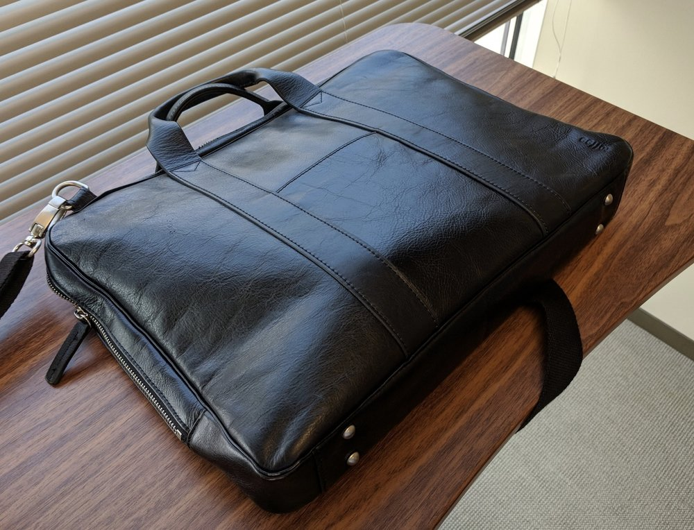 "The Lincoln briefcase features what I would describe as an ""understated business"" look.  It also sports a reinforced base with metal feet, which are great if you have to set your bag down at the airport or in a coffee shop and don't want it to fall over onto the gross floor."