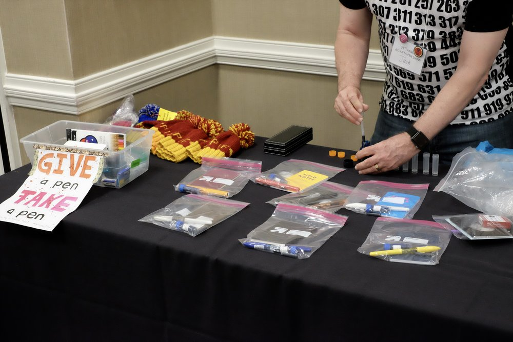 The Pay-it-Forward Table was in full swing with starter packs and the Give a Pen/Take a Pen box.