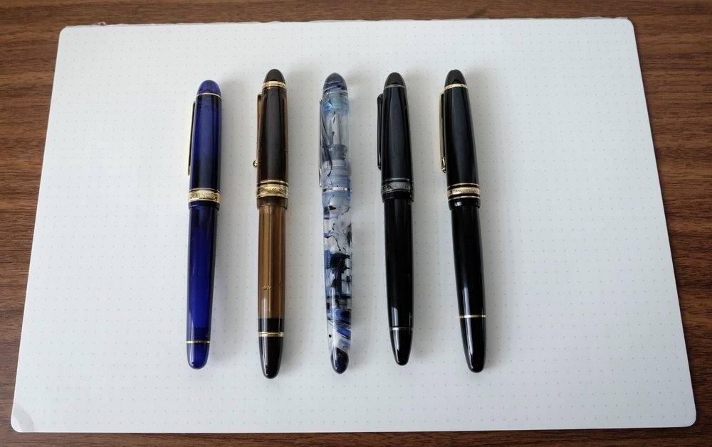 For comparison purposes, from left:  Platinum 3776  in Chartres Blue;  Pilot Custom 823 ; Edison Menlo;  Sailor 1911 Black Luster ; and  Montblanc 146 .