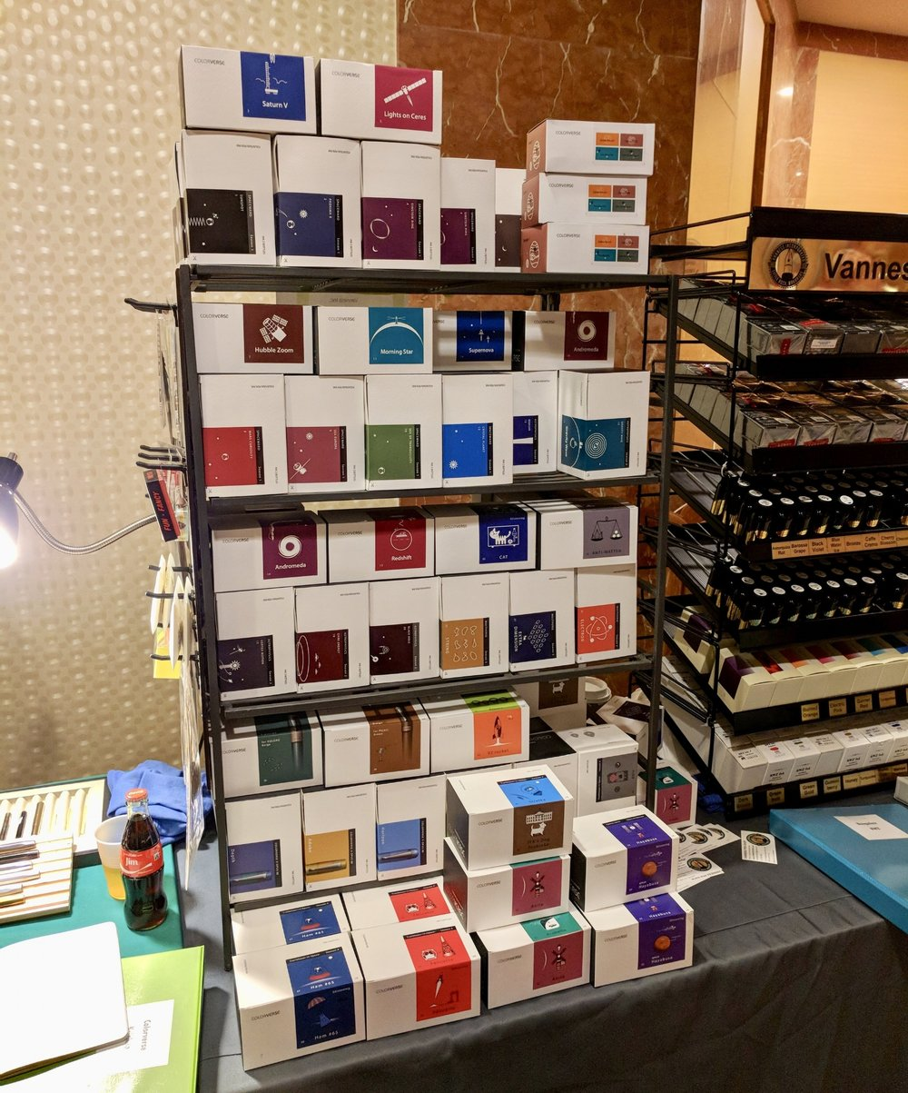 The Colorverse Ink started the show stacked three boxes deep on most colors, but was mostly sold out by Sunday morning.