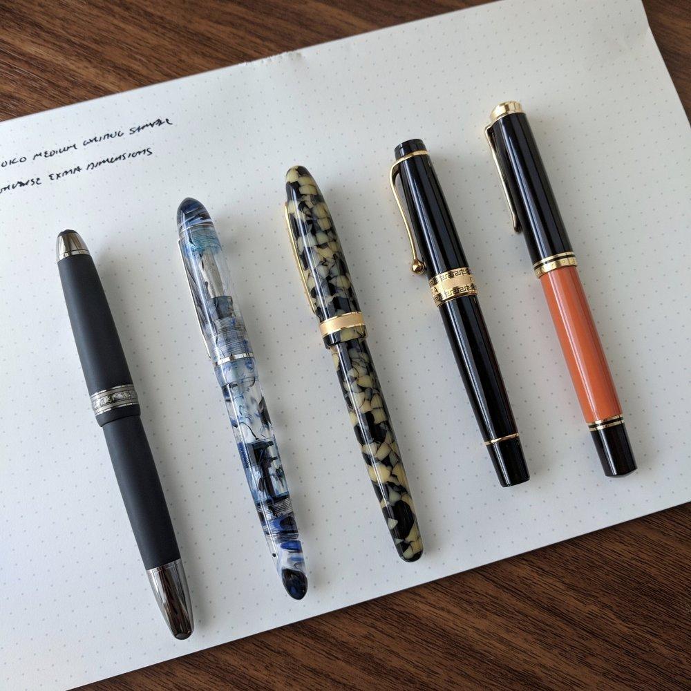Comparison photo, from left:  Montblanc 146 Ultra Black ;  Edison Menlo ; Laban Taroko;  Aurora Optima ; and  Pelikan M800 .
