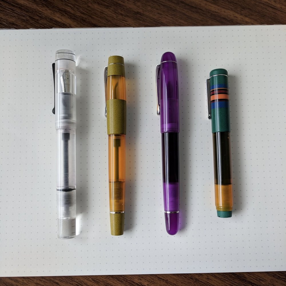 The current Opus 88 model lineup, from left:  Transparent Demonstrator ,  Koloro ,  Picnic , and  Fantasia .