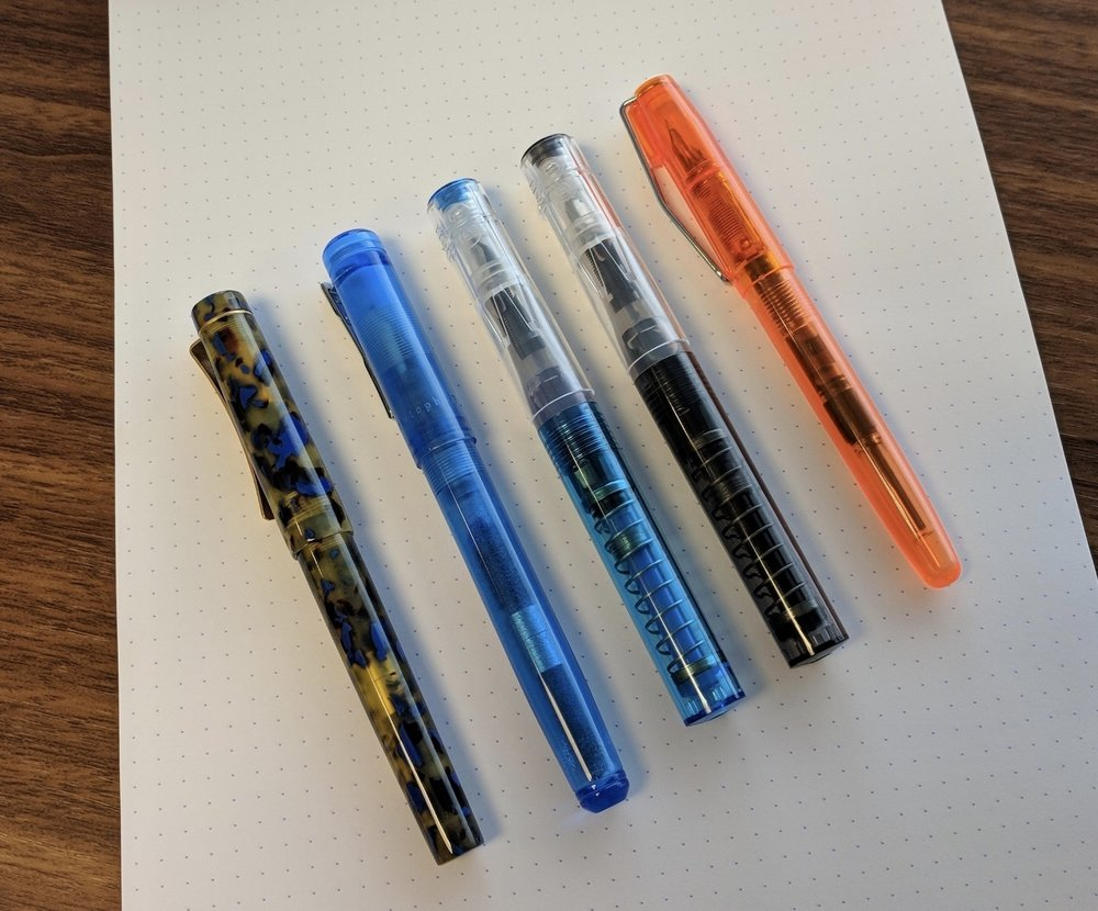 A size comparison with some similar non-TWSBI pens. From left:  Faggionato Petrarque ;  Franklin-Christoph Model 20 ; TWSBI Go in Sapphire; TWSBI Go in Smoke; and last but not least, another great inexpensive demonstrator pen, the  Wing Sung 3010 . (Look for a writeup on that last one sometime soon).