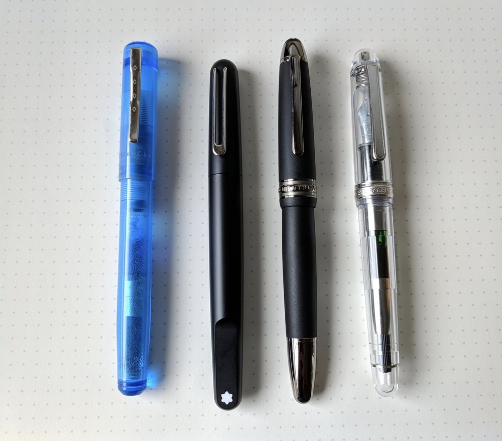 A size comparison shot, from left:  Franklin-Christoph Model 20 , Montblanc M Ultra Black Fountain Pen, Montblanc 146 Ultra Black, and  Platinum 3776 Oshino Demonstrator .