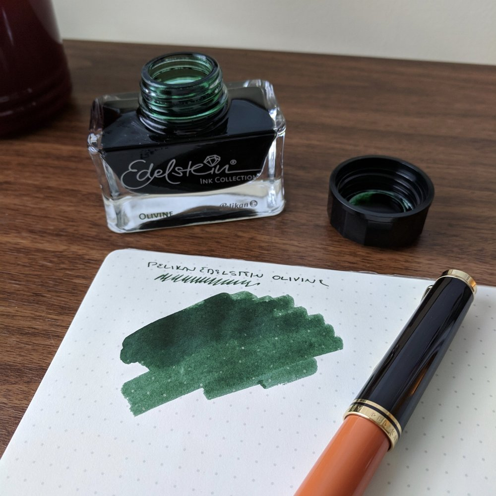 "All Pelikan Hubs attendees receive a bottle of the  Pelikan Edelstein ""Ink of the Year,"" which this year is Olivine , a very nice dark green that I'm looking forward to using."