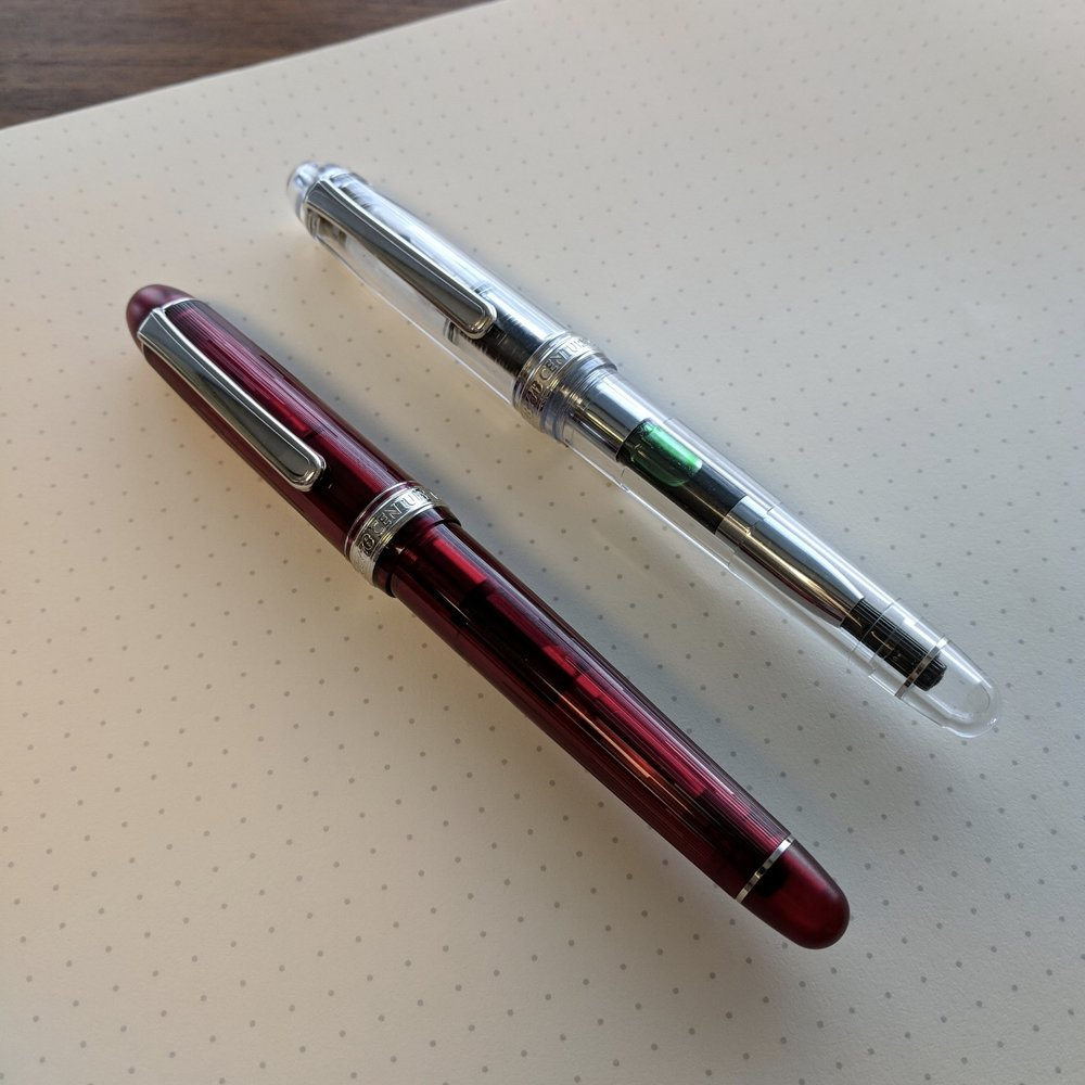 The Shungyo limited edition in my favorite color (red!) on the left, and the crystal clear Oshino demonstrator on the right.